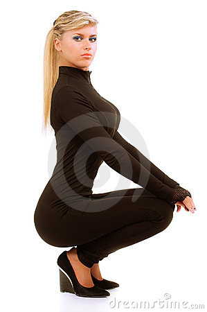 Girl in sports suit squats
