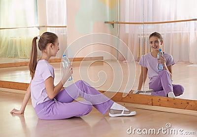 Girl in sportswear with bottle of water.