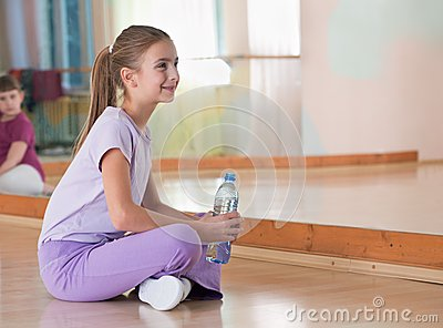 Girl in sportswear with bottle of water