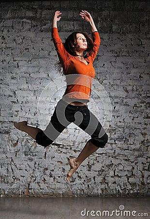 Girl in sportswear jumping