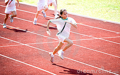Girl sprints towards the finishing line.