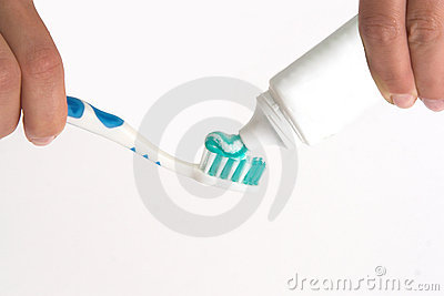 Girl squeezing toothpaste on a