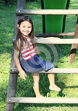 Kid - girl on stairs to slide