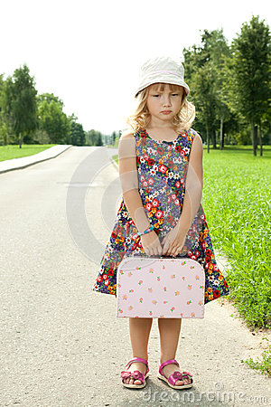 Girl standing alone on the roadside