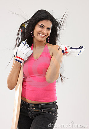 Girl  standing with the cricket bat