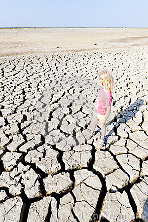 Girl standing on dry land