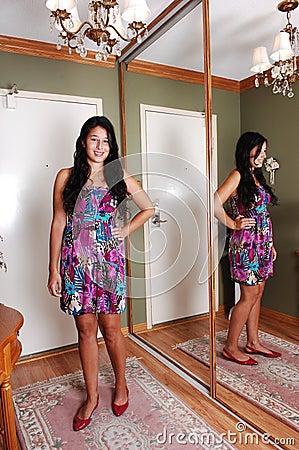 Girl standing in entrance.