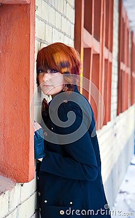 Girl Standing Near a Brick Wall
