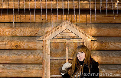 Girl standing near house with icycles