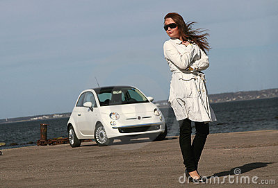 Girl standing next to the car