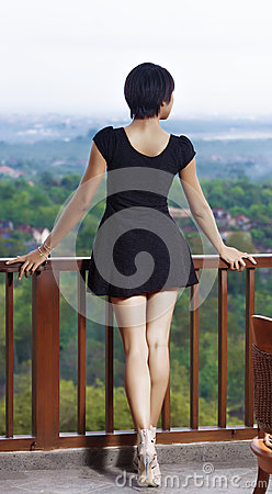 Free Girl Standing On The Balcony, Leaning His Hands On The Railing  Royalty Free Stock Image - 39159536