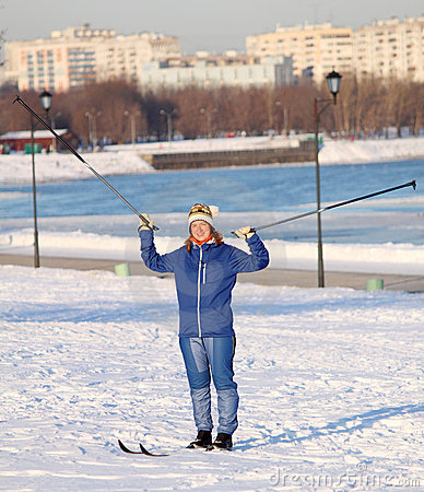 Girl standing on skis with ski poles