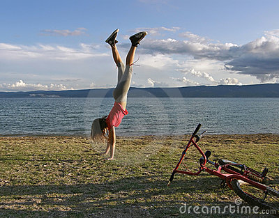 Girl standing upside down