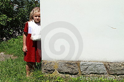 Girl standing by a wall