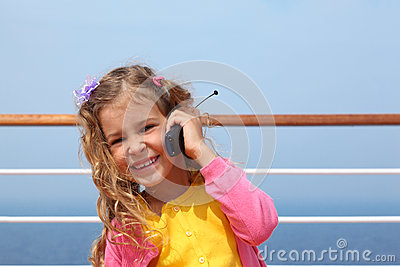 Girl stands on board ship, says by portable radio