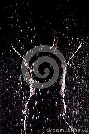 Girl, stands under the water jets