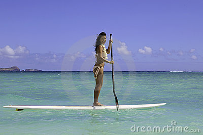 Girl on a standup paddle board