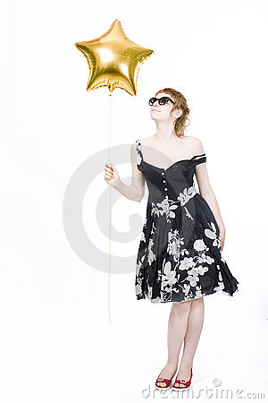Girl with star-shaped balloons