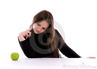 Girl staring at the apple