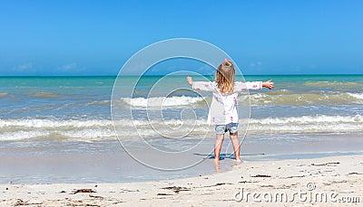 Girl staring  at the ocean