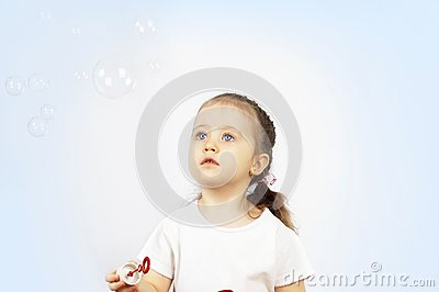 The girl starting up soap bubbles