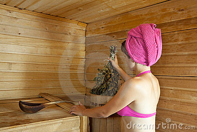 Girl is steamed in  sauna