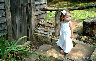 Girl on steps of Cabin
