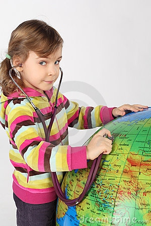Girl with stethoscope and big inflatable globe