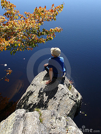 Girl on the stone ashore