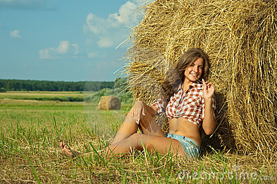 Girl  on straw bale