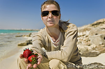 A girl with strawberries