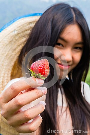 A girl with strawberry.