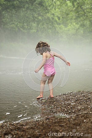 Girl beside a stream