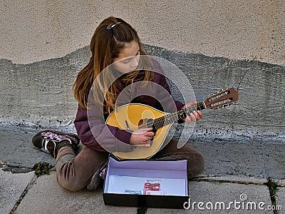 Girl - a street musician