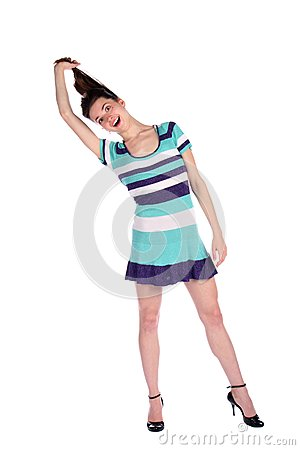 Girl in stripy blue dress pull her hairs.