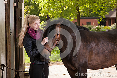 Girl strokes pony