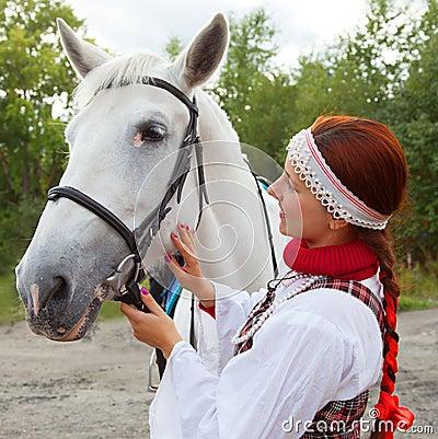The girl stroking horse