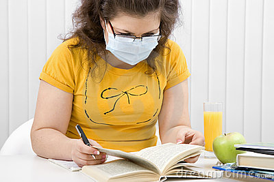 Girl student in a medical mask