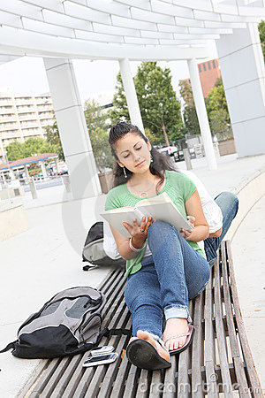 Girl Student Reading on the School Campus
