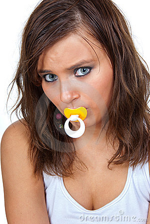 Girl sucking a pacifier