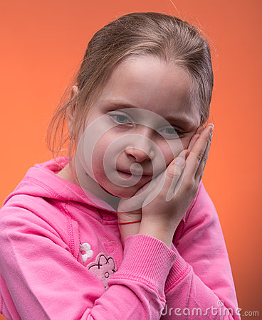 Girl suffering from a toothache