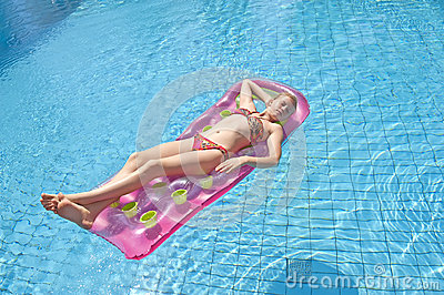 Girl sunbathing on a mattress
