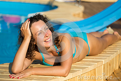 Girl sunbathing at poolside