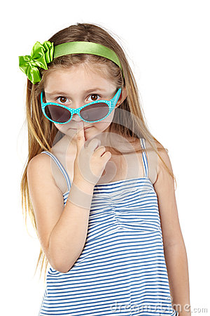 Girl in sundress with sunglasses on tip of nose
