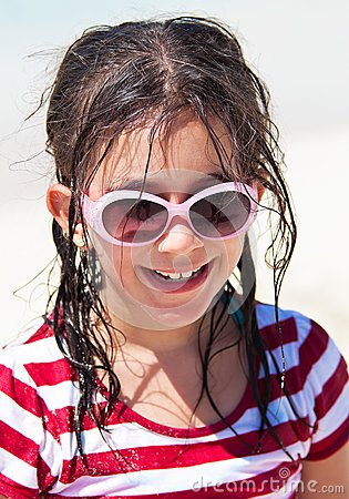 Girl with sunglasses at the beach