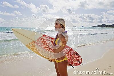 Girl with surfboard at kailua beach