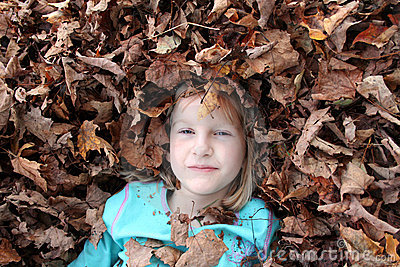 Girl surrounded by leaves