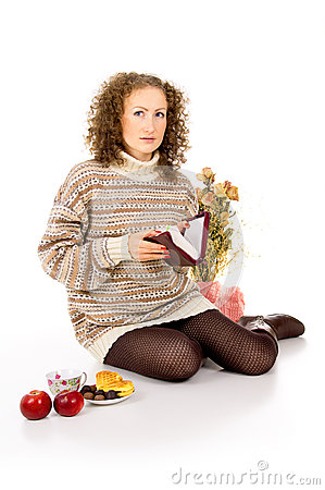 Girl in a sweater with a book of the Bible