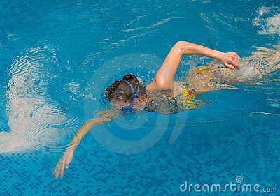 Girl swim in the swimming pool