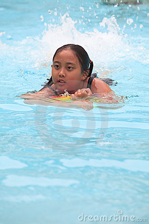 Girl swiming in pool